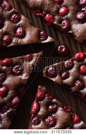 Delicious Chocolate Dessert. Homemade Brownies With Cherries On Oak Board Shaped Like Labyrinth Top