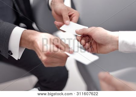 close up.business people exchanging business cards