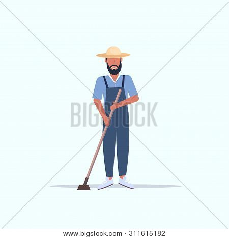 Male Gardener Using Hoe Countryman Hoeing In Garden Planting Harvesting Gardening Eco Farming Concep