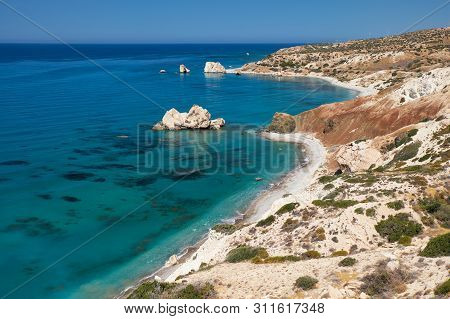 Petra Tou Romiou Or Aphrodite Rock Beach, One Of The Main Attractions And Landmarks Of Cyprus Island