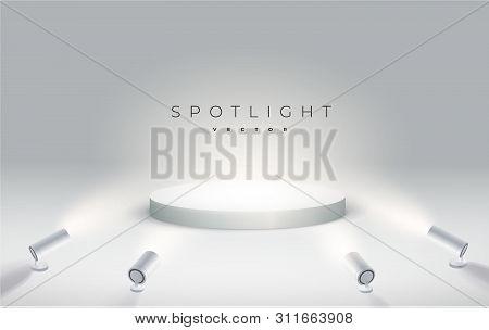 Four Spotlights Shine From The Bottom To The Podium. Round Podium, Pedestal Or Platform Illuminated