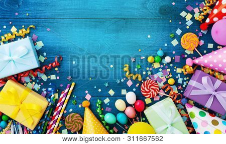 Gift Or Present Boxes, Holiday Supplies And Confetti On Blue Wooden Table Top View. Birthday Party G