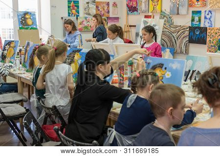 Russia, Tatarstan, April 21, 2019. Childrens Drawing Class. Easel, Canvases, Paints On The Table. A