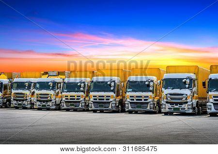 Row Of Cargo Vehicles. Freight Transportation. Cargo Truck Park.