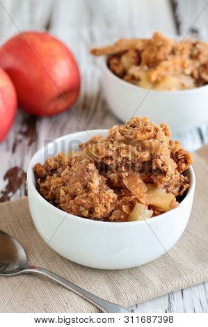 Fresh Hot Homemade Apple Crisp Or Crumble With Crunchy Streusel Topping Topped In A Bowl With Fresh