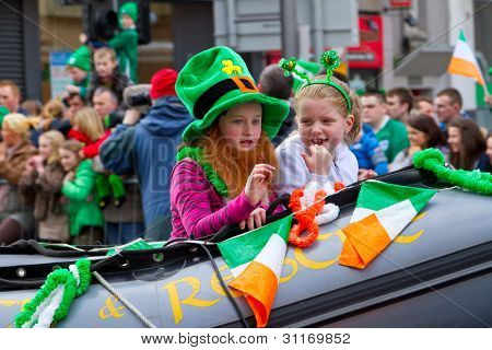 LIMERICK, IRELAND - MARCH 17:Unidentified children with Irish hat  participate in a parade for St. Patrick's Day. It's a traditional Irish holiday celebration. March 17, 2012 in Limerick, Ireland.