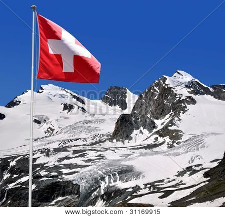 Strahlhorn,Rimpfischhorn and Allalinhorn with Swiss flag - Swiss Alps