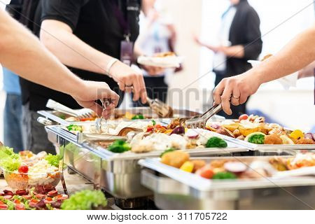 Close Up Of Hands Scooping Food. Buffet Catering Meal Concept.