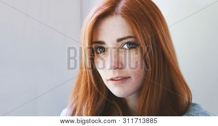 Young Woman With Red Hair And Freckles - Redhead Girl With Freckly Or Freckled Face - Indoor Portrai