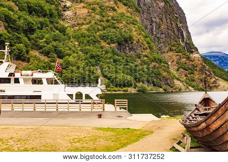 Norwegian Landscape. Ferry And Old Viking Boat On Fjord Sognefjord In Gudvangen Norway Scandinavia.