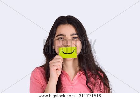 Young Woman Holding Smile Paper On Studio.