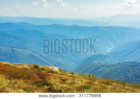 Beautiful Mountain Landscape. View From The Top Of A Hill In To The Valley. Sunny Weather In Late Su