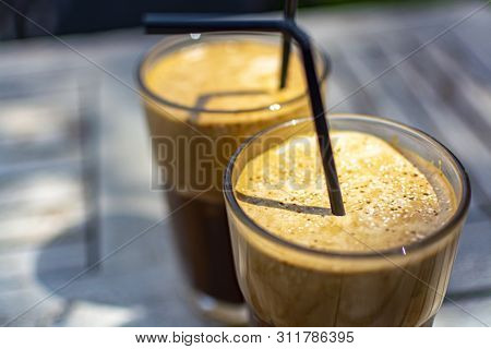 Traditional Greek Cold Coffee Frappe Made From Water, Instant Coffee And Ice Cubes