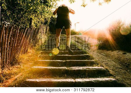 One Person Jumping On Stairs In An Outdoors Training. Helathy Lifestyle Concept
