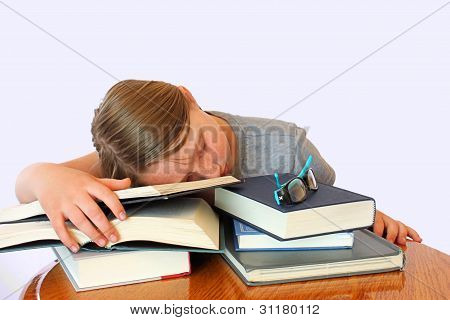 Young Girl With Freckles Sleeping On Books