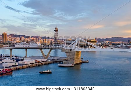 Barcelona, Spain - November 10, 2018: Port Vell With Its Bascule Bridge Porta Deuropa, Containers Of