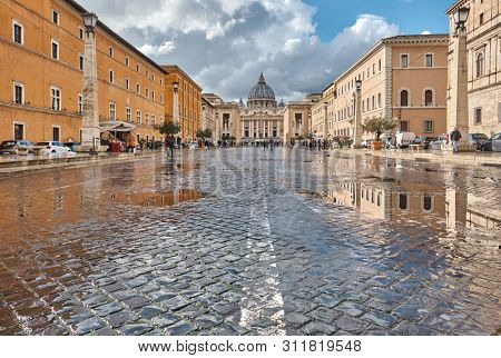 ROME - FEBRUARY 3, 2019: St. Peter's cathedral in Vatican view from Via della Conciliazione (Road of the Conciliation) in Rome, Italy