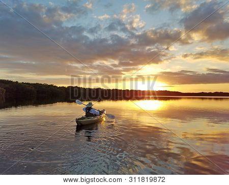 Everglades National Park, Florida 02-05-2017 Active Senior Kayaks On An Exceptionally Calm Coot Bay