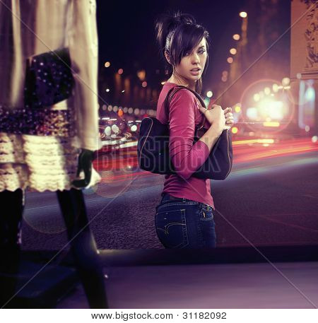 Walking woman looking at shop window