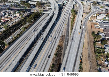 Aerial view of the 105 freeway interchange bridges at the Harbor 110 freeway south of downtown Los Angeles in Southern California.