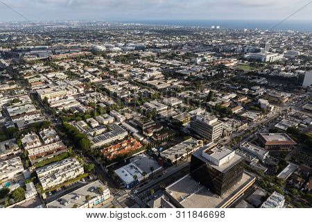 Cityscape aerial view of buildings, homes and streets along Wilshire Blvd in Santa Monica, California.