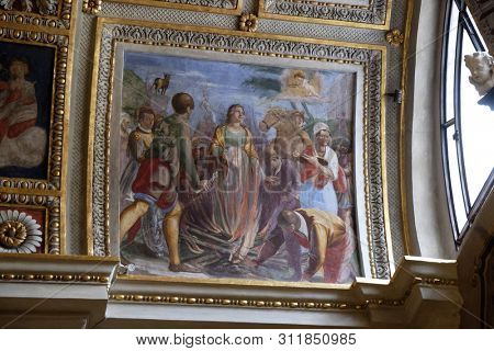 LUGANO, SWITZERLAND - JUNE 24, 2018: Martyrdom of the Saint Apollonia, fresco in the Cathedral of Saint Lawrence in Lugano, Switzerland