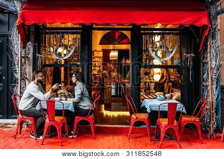 Turkey, Istanbul - October 10, 2018: Happy Couple Drinking Tea In A Street Cafe. Couple In Love In A