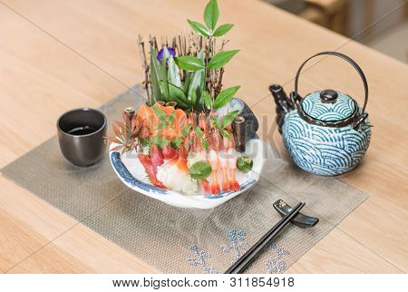 Three Soldiers Guard Sashimi Platter In Japanese Style