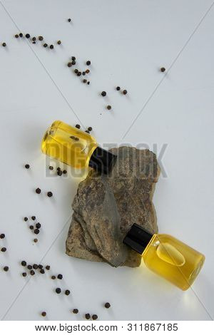 Bottles With Black Peper Essential Oil. Natural Healthy Cosmetic Treatment Products.