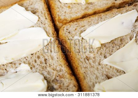 Sliced Toast Bread With Butter Background.