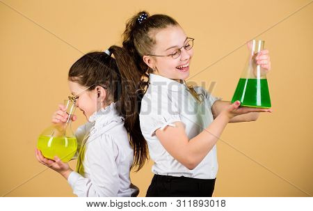 Education concept. Fascinating experiment. Basic knowledge. Knowledge day. Schoolgirls friends with chemical liquids. Childhood and upbringing. Knowledge and information. Experimenting together poster