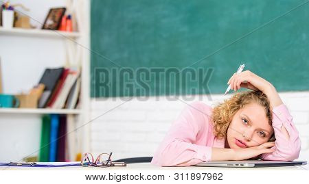 Woman Tired In School Classroom. Teacher Exhausted After Hard Working Day. School Pedagogue Stressfu