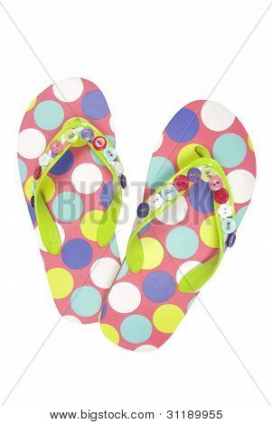 Pair of spoted flip flops on white background. Clipping path included.