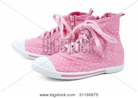 Pink shoes with dots on a white background.