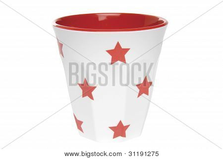Drinking cup with star pattern on white background. Clipping path included.