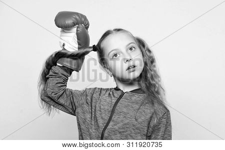 Girl Cute Child With Red Gloves Posing On White Background. Sport Upbringing For Leader. Cute Kid Wi