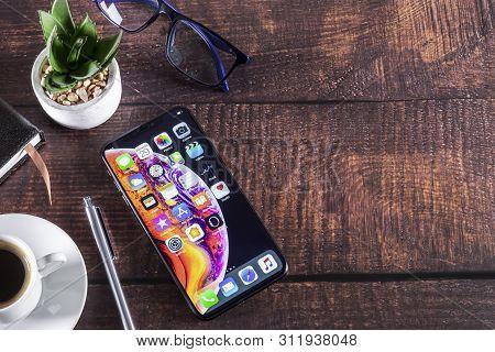 Galati, Romania- May 29, 2019: Apple Computers Iphone Xs On Luxury Furniture Wooden - Smartphone Tel