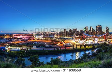Calgary, Canada - July 14, 2019: Panorama Of Sunset Blue Hour Over The Calgary Stampede Fairgrounds