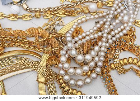 Pearl Beads With Jewelry On A White Background. Jewelry Background.