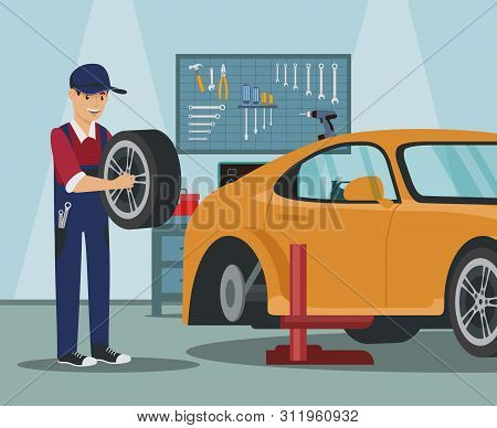 Worker With Wheel In Hand. Car Wheel Replacement. Wheel Change In Car. Service Station. Auto Service