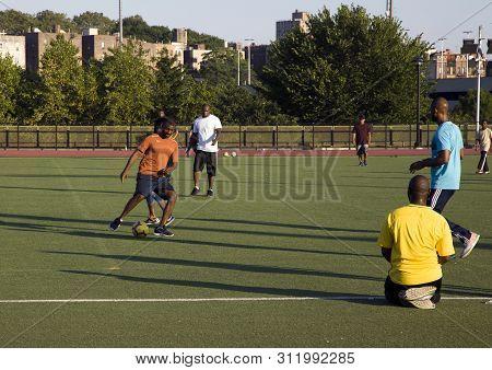 Bronx, New York/usa - July 4, 2019: Men Play A Game Of Soccer On Field Near Yankee Stadium.
