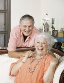 Affectionate senior man and woman at home poster