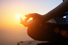 Young Women Meditate While Doing Yoga Meditation, Spiritual Mental Health Practice With Silhouette O