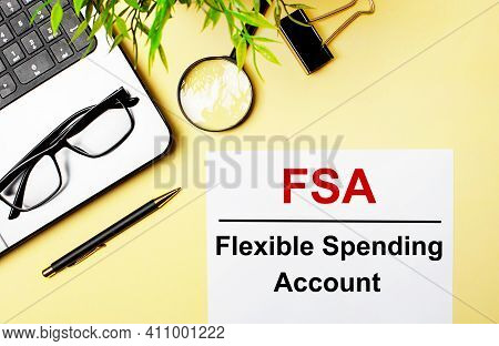 Fsa Flexible Spending Account Is Written In Red On A White Piece Of Paper On A Light Yellow Backgrou