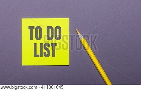 On A Gray Background, A Bright Yellow Pencil And A Yellow Sticker With The Word To Do List