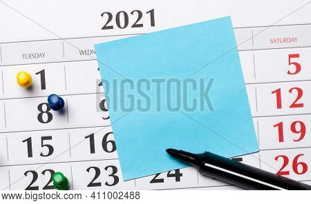 The Calendar Has A Blue Sticker And A Black Marker. Organizational Concept. Top View With Copy Space