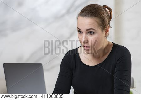 Wondered Surprised Beautiful Girl, Young Excited Shocked Woman Looking At Screen Of Her Laptop Compu