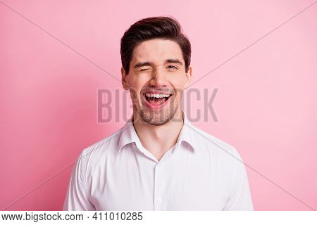 Portrait Of Optimistic Guy Blink Wear White Shirt Isolated On Pink Color Background