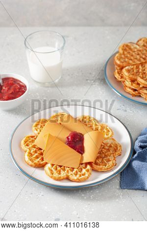 waffles with Norwegian brunost traditional brown cheese and raspberry jam