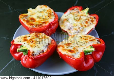 Plate Of Mouthwatering Homemade Stuffed Bell Peppers  Isolated On Black Background